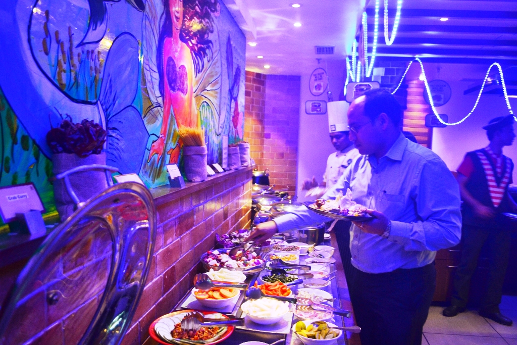 A Guest enjoys the buffet at Barbeque Nation during the Sea Food Festival 2